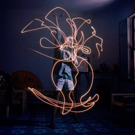 Artist Pablo Picasso drawing an image using a light pen
